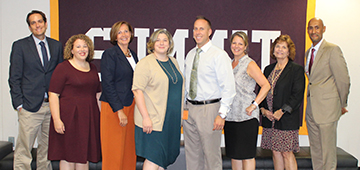 A groups of administrators pose for a photo at the September Board of Education Meeting.